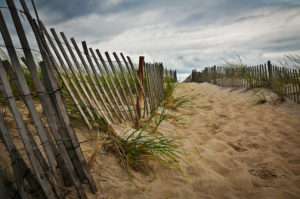 "A Cloudy Day at the Beach"" by John St. John licensed under CC 2.0"